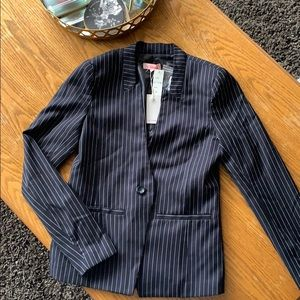 Two-piece pinstripe suit with padded shoulders